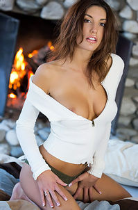 August Ames Near The Fireplace