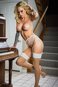 Tattoed Babe Sarah Jessie Posing Near Piano